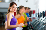 People in gym on treadmill running - 34756464