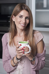 Smiley woman with a cup