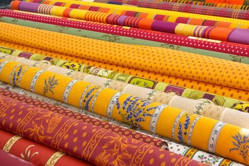 Rolls of fabric on a market stall