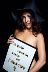 Naked witch with sign