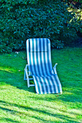 deck chair on the grass without people