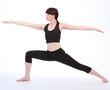 Exercising Yoga Warrior Two pose Virabhadrasana