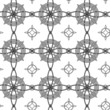 Geometrical seamless pattern with intertwining black circle.
