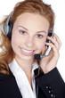 Junge Frau im Service mit Headset lächelt freundlichst