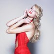 Young pretty blond woman in a fashionable dress