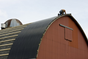 roofing a red barn
