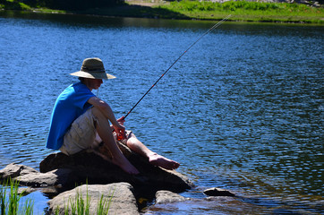 Teenage Boy Fishing on a Lake