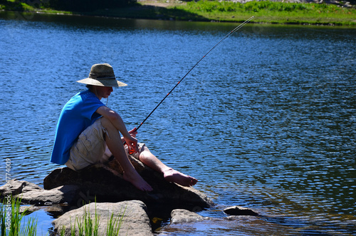 Teenage Boy Fishing on a Lake