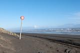 Speed sign on the ocean beach - 34774693