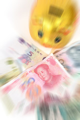 Chinese currency and piggy bank