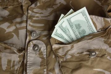 Dollars in a british desert uniform pocket
