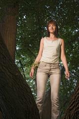 girl standing between trunks