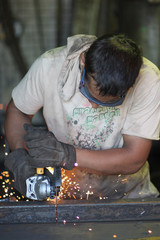 Man and angular grinder.
