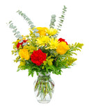 Colorful flower arrangement centerpiece in glass vase