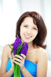 Beautiful woman with holding flowers