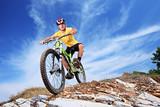 A young male riding a mountain bike