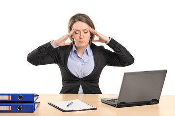 A young businesswoman in pain as a result of a headache posing