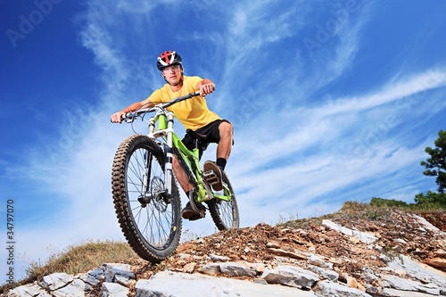 A young male riding a mountain bike