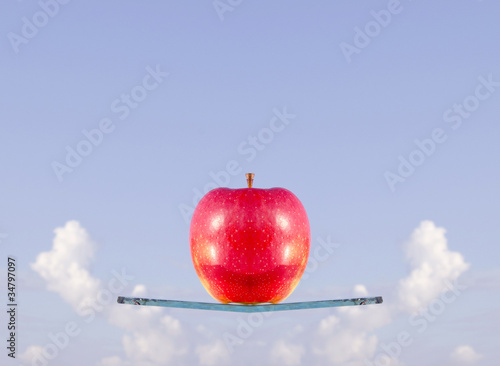 red apple levitation on the glass ship