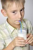 smiling boy drinking milkshake