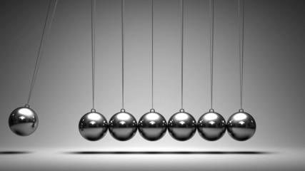 Balancing balls Newton's cradle on grey background