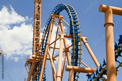 roller coaster against blue spring sky