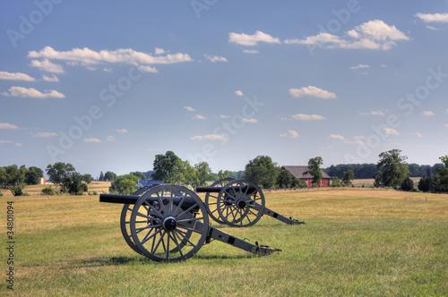 Two civil war era cannons in open field
