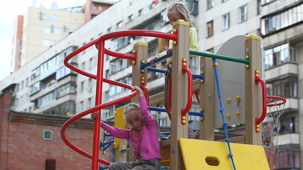 Two little girls spending time in playground