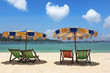 Multi-colored beach umbrellas and chaise lounges