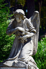 Skillful stone angel on the tomb