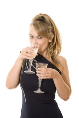 woman in party dress with two glasses of wine