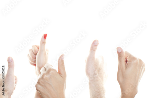 Many of thumb in front of a white background to show up