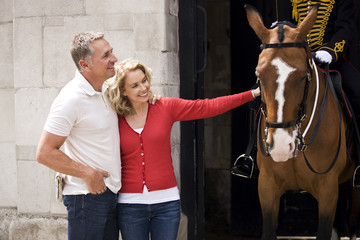 A middle-aged couple standing at Horse Guards