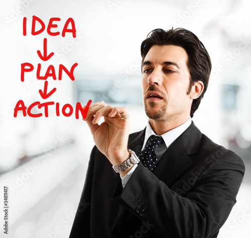 Businessman writing an action plan