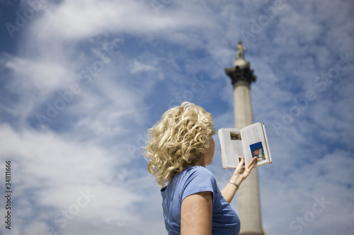 A middle-aged woman in front of Nelson's column