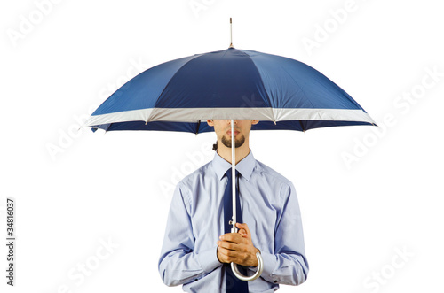 Businessman holding umbrella in the office