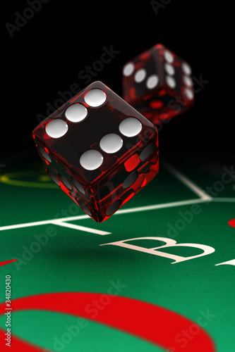 Two dice over craps table with selective focus