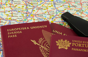 EU passports on a map and a car key