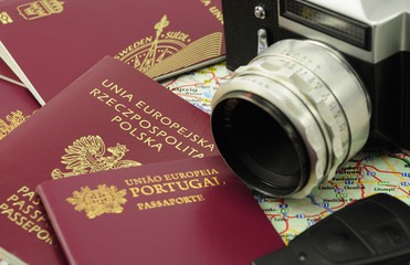 EU passports on a map with car key and camera