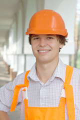 Smiling young worker with copy space