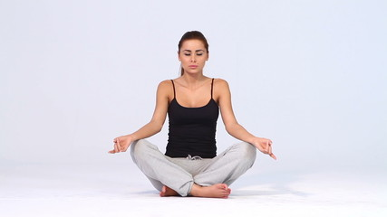 Cute woman doing yoga on white background