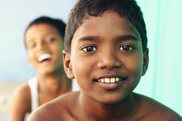 Two Indian boys posing to the camera.