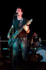 Electric bass-guitar player
