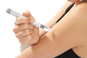 Diabetes female doing human insulin vaccination shot by syringe