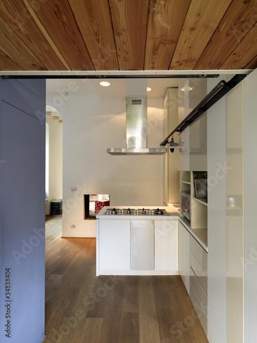 Cucina moderna con pavimento in legno di adpephoto foto - Abbonamento cucina moderna ...