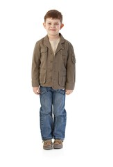 Little boy in autumn clothes smiling