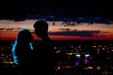 couple silhouette at night city