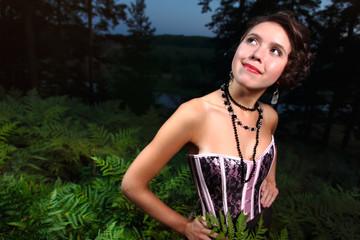 Beautiful girl in dress night forest