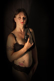 A Pretty Brunette Holding Replica Gun poster