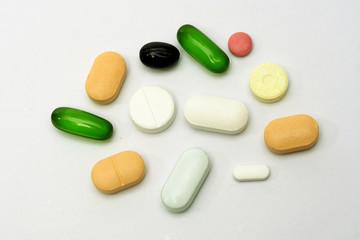 Variety of pills on white